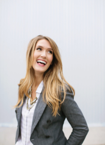 woman in a blazer laughing